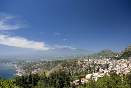 ionian: taormina sicily italy panoramic view of town and mt. etna and ionian sea