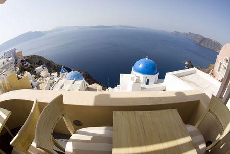 fish-eye birds eye view over classic cyclade greek island church over sea santorini greece