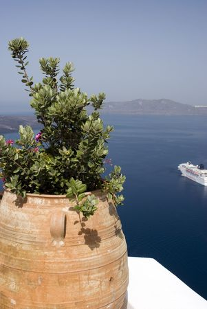 aegean: harbor view of cruise ship with flower pot santorini greek islands