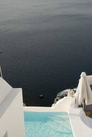 santorini swimming pool at villa with incredible beautiful view over the sea greek islands photo