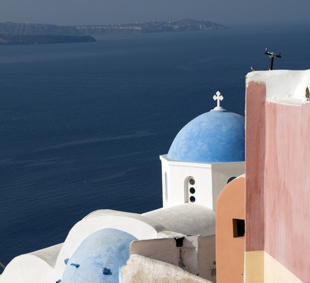 classic greek church over aegean sea santorini greek islands photo