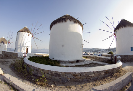 famous windmills in harbor of mykonos island greece fish-eye view photo