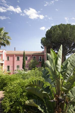 sicily garden with villa in background italy photo