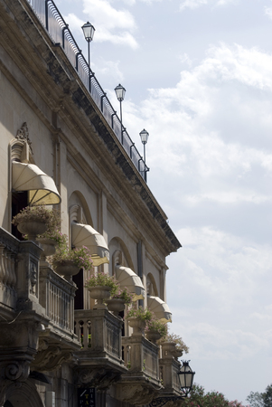 sicily architecture, typical street scene taormina italy  photo