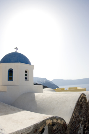 greek church view and generic architecture over caldera santorini photo