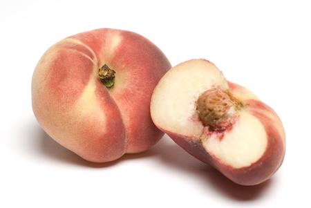 a rare: donut peach exotic rare sweet fruit also known as chinese flat peach or saucer peach