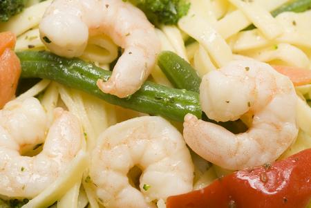 primavera: shrimp scampi primavera with linguine broccoli vegetables Stock Photo
