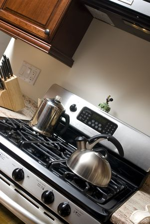 stainless steel stove with coffee pot and tea pot in kitchen Stock Photo - 2084772