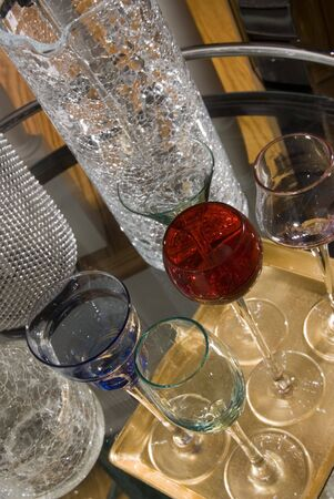 seltzer: fancy cocktail glasses and crackled glass mixing piece on rolling bar