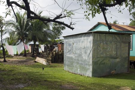 typical sheet metal house and yard with chickens big corn island nicaragua central america caribbean Stock Photo - 2177379