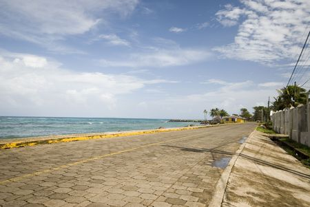 north   end: corn island waterfront north end nicaragua rural cobblestone road Stock Photo