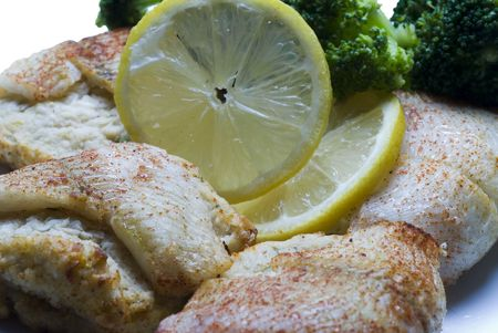 fish stuffed filet of sole flounder with crab meat and broccoli and lemon slice