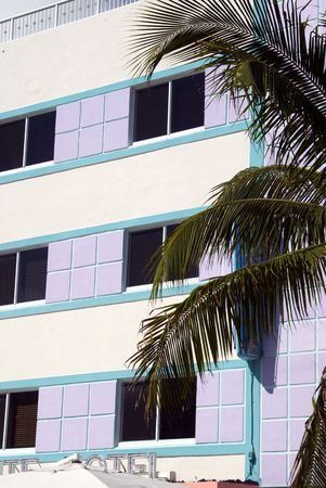 rejuvenated: architecture art deco hotel facade south beach miami florida with palm tree
