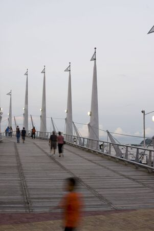 evening out: people out for an evening stroll on the malecon 2000 guayaquil ecuador south america