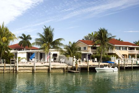 canal channel with boats and houses florida keys typical architecture scene photo