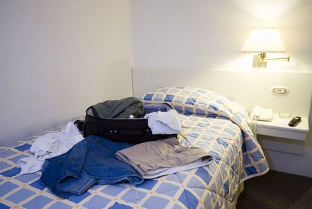 messy: hotel room with open suitcase guayaquil ecuador south america Stock Photo