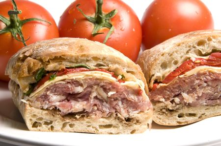 gourmet sandwich prosciutto ham asiago cheese with roasted peppers arugula lettuce on italian ciabatta bread photo