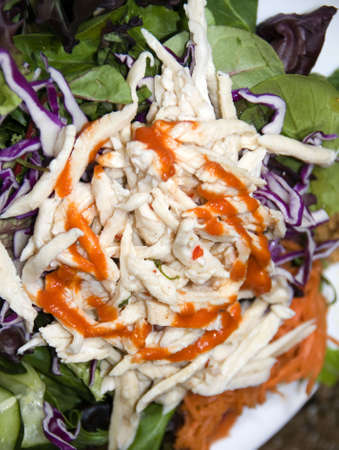 goi: vietnamese food chicken salad called goi ga with shredded cabbage onions  greens and herbs with crushed peanuts