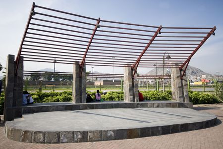 the wall park lima peru stagewith view of mountains and residences with tourists Stock Photo