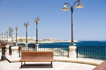 mediterranean seaside promenade with benches and hotels sliema malta europe