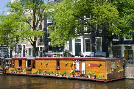 streetscene: house boat with flowers canal scene amsterdam holland
