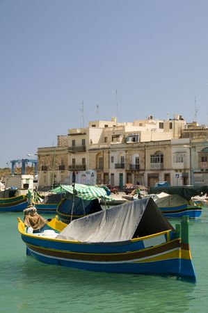 Malta Marsaxlokk native fishing boat luzzus, luzzu wooden archtitecture fishing village Mediterranean sea Фото со стока