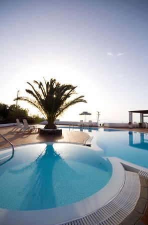luxurious: swimming pool with mediterranean sea view oia ia santorini thira greek cyclades islands greece