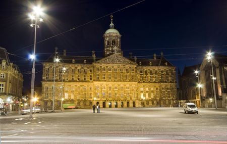dam square: royal palace at night next to nieiwe kerk new church on dam square amsterdam holland netherlands