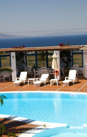 swimming pool with mediterranean sea view oia ia santorini thira greek cyclades islands greece photo