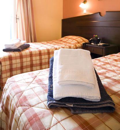 bedspread: typical greek island hotel room santorini greece cyclades islands Stock Photo