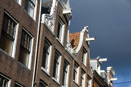 architectural feature: The historic canal houses in Amsterdam are built leaning forward with hoist lifts on their top floor.  This is to make it easy to lift furniture and objects into the often times very narrow houses with very steep steps.  This architectural feature is seen