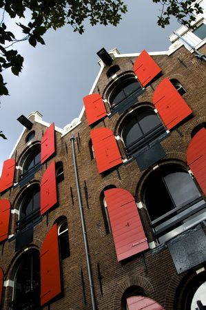 leaning forward: The historic canal houses in Amsterdam are built leaning forward with hoist lifts on their top floor.  This is to make it easy to lift furniture and objects into the often times very narrow houses with very steep steps.
