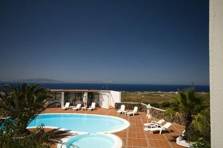 swimming pool with mediterranean sea view oia ia santorini thira greek cyclades islands greece