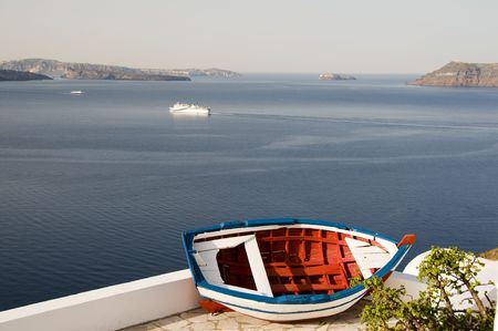 ia: old wood fishing boat caldera view mediterranean aegean sea oia ia santorini greek islands greece