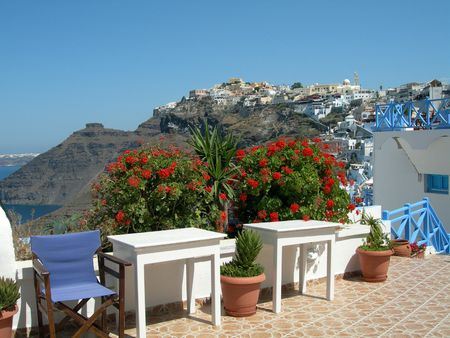 thira:  restaurant with volcanic cliff caldera view greek islands greece santorini thira ia oia town