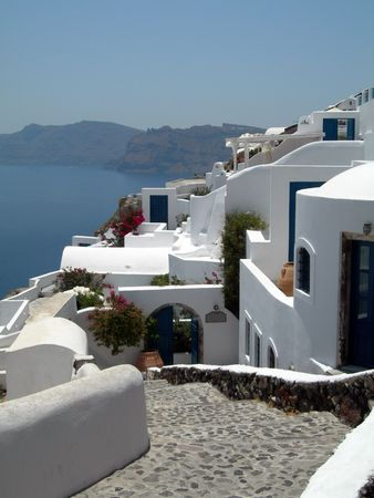 ia:  hotel view traditional  with volcanic cliff caldera view greek islands greece santorini thira ia oia town Stock Photo