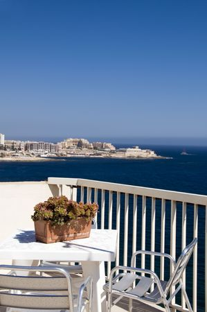 sliema malta rooftop hotel cafe view of mediterranean coast st. julians harbor and paceville hotels and development coastline photo