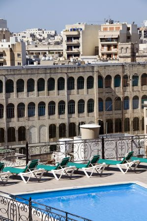 awnings: malta architecture arches rooftops with hotel swimming pool sliema mediterranean europe