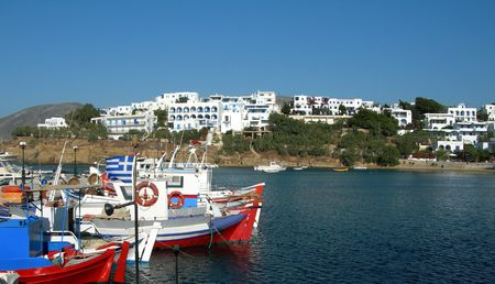 cyclades: greek fishing boats in harbor piso livadi paros island with cyclades architecture resort town