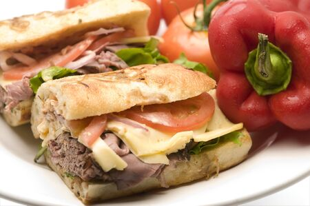 gourmet roast beef sandwich havarti cheese lettuce tomato red onion remoulade dressing on rustic rosemary bread photo