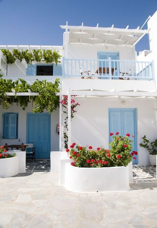 cyclades: greek island apartment hotel cyclades architecture white plaster generic blue doors Stock Photo