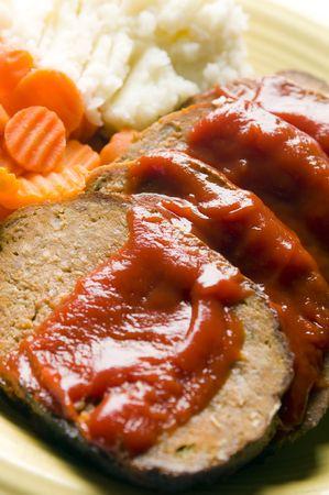 meatloaf meat loaf sliced carrots mashed potatoes