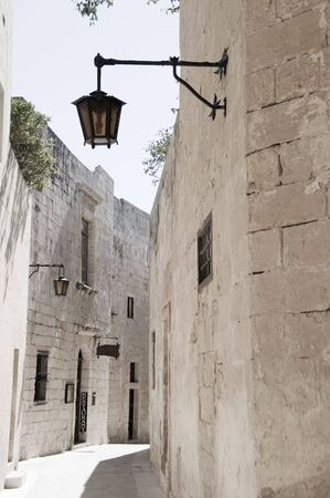 mdina malta alley street ancient medieval town old architecture with maltese street lamp photo
