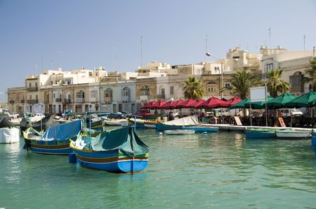 marsaxlokk malta old fishing village with ancient architecture and luzzu classic fishing boats in harbor mediterranean sea