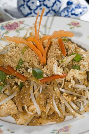 chicken pad thai food thailand stir fried noodles onion scallion, bean sprouts and egg with crushed peanuts at thai restaurant photo