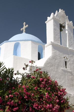 greek island church blue dome with steeple bell tower  photo