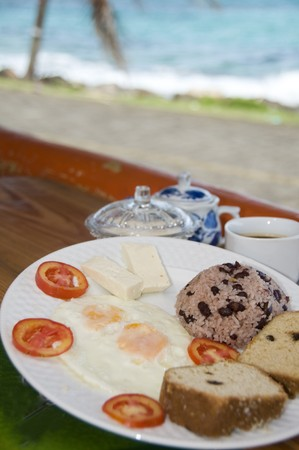 nicaraguan: Nicaraguan typical breakfast gallo pinto rice beans fried eggs cheese coconut bread by the sea photographed in Nicaragua Corn Island