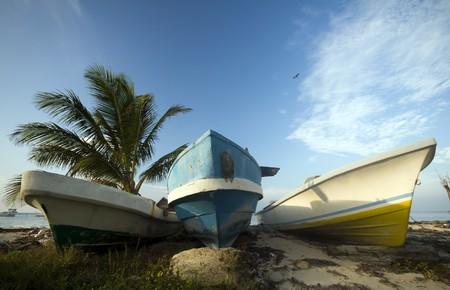 three fishing boats on shore caribbean sea beach corn island nicaragua photo