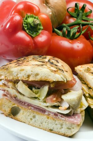 gourmet hot ham sandwich rosemary bread with variety of ham and italian salami photo