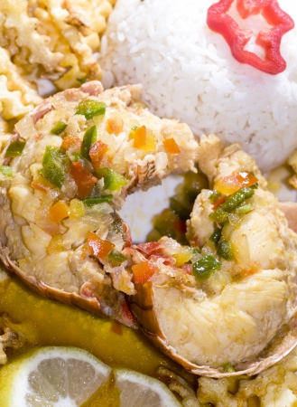 lobster tail: caribbean lobster tail dinner with rice french fried potatoes and butter photographed in Nicaragua